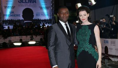 Actor David Oyelowo and wife Jessica pose for photographers at a central London cinema, Tuesday, Jan. 27, 2015, for the European premiere of Selma, a film about a three month campaign led by Martin Luther King Jr, which culminated in a march from Selma to Montgomery, Alabama, USA. (Photo by Joel Ryan/Invision/AP)