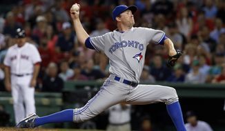 Toronto Blue Jays relief pitcher Casey Janssen delivers to the Boston Red Sox during the ninth inning of a baseball game at Fenway Park in Boston, Tuesday, July 29, 2014. (AP Photo/Elise Amendola)