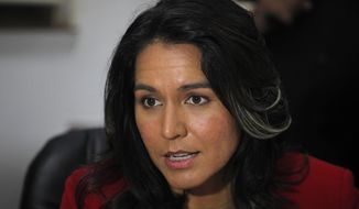 Rep. Tulsi Gabbard, Hawaii Democrat, speaks during a meeting at Gujarat Chamber of Commerce and Industry (GCCI) in Ahmadabad, India, on Dec. 27, 2014. Gabbard is on an official visit to India. (Associated Press) **FILE**