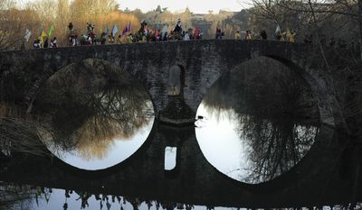 PAMPLONA, SPAIN -The Cabalgata Los Reyes Magos  (Cavalcade of the three kings) cross Magdalena bridge over Arga River the day before Epiphany, in Pamplona, northern Spain, Monday, Jan. 5, 2015. It is a parade symbolizing the coming of the Magi to Bethlehem following the birth of Jesus. In Spain and many Latin American countries Epiphany is the day when gifts are exchanged. (AP Photo/Alvaro Barrientos)