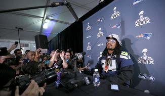 Seattle Seahawks' Marshawn Lynch attends a news conference for NFL Super Bowl XLIX football game, Wednesday, Jan. 28, 2015, in Phoenix. The Seahawks play the New England Patriots in Super Bowl XLIX on Sunday, Feb. 1, 2015. (AP Photo/Matt York)