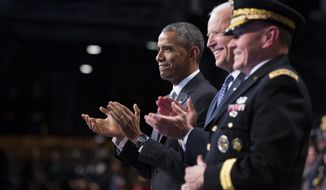President Barack Obama, left, Vice President Joe Biden, center, and Chairman of the Joint Chiefs of Staff Gen. Martin Dempsey applaud outgoing Secretary of Defense Chuck Hagel during a celebration in honor of Mr. Hagel's service, on Wednesday, Jan. 28, 2015, in Fort Myer, Va. Mr. Obama, Vice President Joe Biden and top military brass praised Mr. Hagel at a farewell ceremony at Joint Base Fort Myer-Henderson Hall. Mr. Obama said the country is grateful for military progress on Hagel's watch.(AP Photo/Evan Vucci)