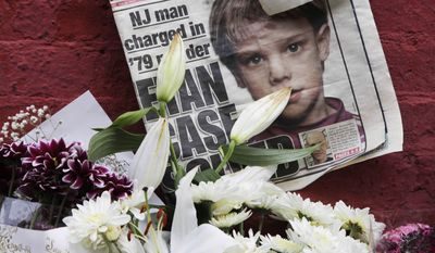FILE - This May 28, 2012, file photo shows a newspaper with a photograph of Etan Patz at a makeshift memorial in the SoHo neighborhood of New York where Patz lived before his disappearance on May 25, 1979. The memorial was set up near a building that housed a convenience store where Pedro Hernandez, accused of killing Patz, told police 33 years after they boy's disappearance, that he choked the 6-year-old and put the still-living boy into a plastic bag, boxed up the bag and left it on a street. Opening statements in Hernandez's trial are set for Friday, Jan. 30, 2015. (AP Photo/Mark Lennihan, File)
