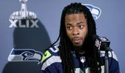 Seattle Seahawks' Richard Sherman answers a question at a news conference for NFL Super Bowl XLIX football game, Wednesday, Jan. 28, 2015, in Phoenix. The Seahawks play the New England Patriots in Super Bowl XLIX on Sunday, Feb. 1, 2015. (AP Photo/Matt York)