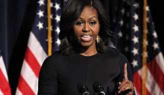 First lady Michelle Obama speaks during the launch event for Got Your 6, a multifaceted program that includes encouraging film and television to include characters who are veterans, Friday, Jan. 30, 2015, at the National Geographic Society in Washington. (AP Photo/Jacquelyn Martin)