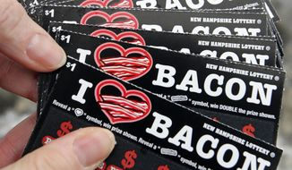 For Valentine's Day, maybe the man in your life would like something with bacon -- a fancy meal, or bacon candy, or even some bacon-scented scratch-and sniff lottery tickets? (AP Photo/Jim Cole)