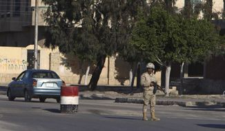 An Egyptian soldier mans a checkpoint in el-Arish, 290 kilometers (180 miles) east of Cairo, North Sinai, Egypt, Saturday, Jan. 31, 2015. Egyptian President Abdel Fattah al-Sissi told the nation in a televised address Saturday to prepare for a long fight to defeat Islamic extremists following a wave of attacks on security forces in the Sinai Peninsula. An Islamic State-linked group in Egypt claimed responsibility for a string of bomb and gun attacks Thursday night targeting Egyptian military positions that killed at least 30 security force members. (AP Photo)