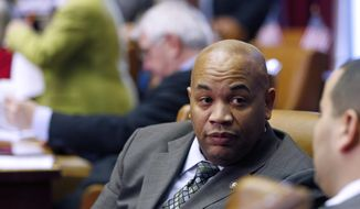 FILE - In this Jan. 22, 2014 file photo, Assemblyman Carl Heastie, D-Bronx, a sponsor to raise the state's minimum wage, works in the Assembly Chamber at the state Capitol in Albany, N.Y.  Sheldon Silver announced his resignation as two lawmakers jockeyed for his position Friday, Jan. 30, 2015 following federal charges that the longtime leader took nearly $4 million in kickbacks.  Majority Leader Joseph Morelle dropped out of the race and threw his support to Heastie, who appears to have the job locked up. Assemblywoman Catherine Nolan of Queens remains the only other candidate. (AP Photo/Mike Groll)