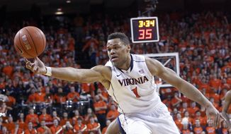 Virginia guard Justin Anderson goes after a rebound during the first half of an NCAA college basketball game against Duke in Charlottesville, Va., on Saturday, Jan. 31, 2015. (AP Photo/Ryan M. Kelly)
