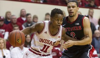 Indiana guard Yogi Ferrell (11) drives against Rutgers guard Bishop Daniels (2) during the second half of an NCAA college basketball game, Saturday, Jan. 31, 2015, in Bloomington, Ind. Indiana defeated Rutgers 72-64. (AP Photo/Doug McSchooler)