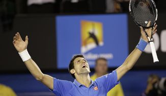 Novak Djokovic of Serbia celebrates after defeating Andy Murray of Britain in the men's singles final at the Australian Open tennis championship in Melbourne, Australia, Sunday, Feb. 1, 2015. (AP Photo/Bernat Armangue)