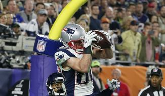 New England Patriots wide receiver Danny Amendola (80) catches a four-yard touchdown pass in front of Seattle Seahawks free safety Earl Thomas (29) during the second half of NFL Super Bowl XLIX football game Sunday, Feb. 1, 2015, in Glendale, Ariz. (AP Photo/Matt York)