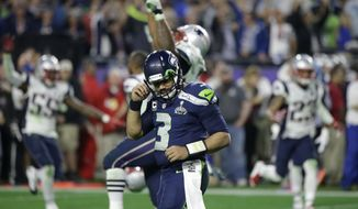 Seattle Seahawks quarterback Russell Wilson (3) reacts after throwing an interception to New England Patriots strong safety Malcolm Butler during the second half of NFL Super Bowl XLIX football game Sunday, Feb. 1, 2015, in Glendale, Ariz. (AP Photo/David Goldman)