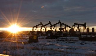 In this Wednesday, Jan. 14, 2015, photo, oil pump jacks are seen McKenzie County, in western North Dakota. Roughly 60 rigs are drilling in surrounding McKenzie County, 40 percent of the rigs statewide.  But now that those prices have tumbled, the shifting oil market threatens to put the industry and local governments on a collision course. (AP Photo/Matthew Brown)