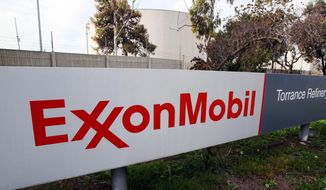 This Jan. 30, 2012, file photo, shows the sign for the ExxonMobil Torerance Refinery in Torrance, Calif. Exxon Mobile on Monday, Feb. 2, 2015, reported fourth-quarter earnings of $6.57 billion. (AP Photo/Reed Saxon, File)