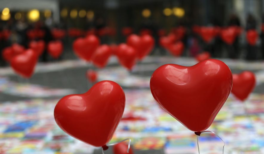 """During February's American Heart Month, many of us will """"Go Red For Women"""" so we can raise awareness, encourage action, and save lives that are lost too early. (AP Photo)"""