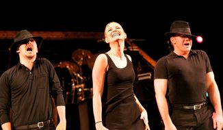 "In this image Jan. 29, 2015 photo released by Starpix, Grammy Award Winner Jennifer Nettles, center, rehearses for her Broadway role as Roxie Hart in the musical ""Chicago,"" in New York. Nettles will debut on Monday, Feb. 2 at the Ambassador Theatre in New York. (AP Photo/Starpix, Aurora Rose)"