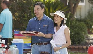 "In this image released by ABC, Randall Park, left, and Constance Wu appear in a scene from the new comedy series ""Fresh Off the Boat,"" previewing Wednesday with episodes at 8:30 p.m. and 9:30 p.m. EST. (AP Photo/ABC, Nicole Wilder)"