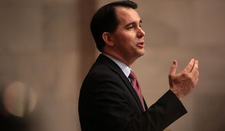 Wisconsin Gov. Scott Walker delivers his state budget address at the Wisconsin state Capitol in Madison, Wis. Tuesday, Feb. 3, 2015. (AP Photo/Wisconsin State Journal, John Hart)