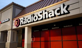 This Tuesday, Feb. 3, 2015 photo shows a RadioShack store in Dallas. The company that introduced the first mass-market personal computer, is fading after years of heavy losses and the suspension of its shares. (AP Photo/Tony Gutierrez)