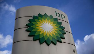 A Thursday, Jan. 15, 2015 file photo showing a BP logo outside a petrol station in the town of Bletchley in Buckinghamshire, England. Oil giant BP reported a loss Tuesday, Feb. 3, 2015, of $4.4 billion for the fourth quarter of 2014, as oil prices plunged. The net income figure includes a $5 billion writedown on the value of BP's inventories, after the price of Brent crude, the benchmark for North Sea oil, dropped almost 50 percent last year. BP posted a profit of $1.04 billion in the fourth quarter of 2013. After stripping out the effect of the drop in oil prices, BP reported a loss of $969 million for the period, compared with a gain of $1.5 billion last year. (AP Photo/Matt Dunham, File)