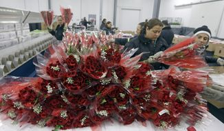 Workers prepare flowers for distribution to local merchants in preparation for Valentine's Day, at the South Florida Logistics Center in Miami, Tuesday, Feb. 3, 2015. (AP Photo/Alan Diaz) **FILE**