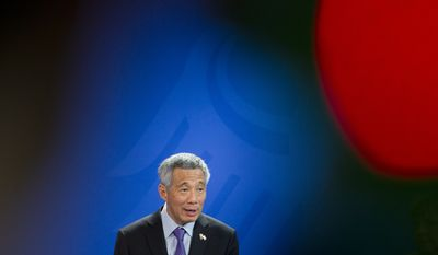 Prime Minister of Singapore Lee Hsien Loong addresses the media during a joint press conference as part of a meeting with German Chancellor Angela Merkel at the chancellery in Berlin, Germany, Tuesday, Feb. 3, 2015. (AP Photo/Steffi Loos)