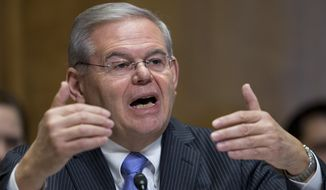 Sen. Robert Menendez, New Jersey Democrat, questioned witnesses about sex trafficking and other abuses during a recent hearing on Cuba. (AP Photo/Manuel Balce Ceneta)