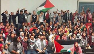 "Activists waving Palestinian flags reportedly heckled Jewish students at the University of California, Davis and chanted ""Allahu Akbar"" during a student government vote last week to call on the school to boycott Israel. (Azka Fayyaz via Washington Free Beacon) ** FILE **"