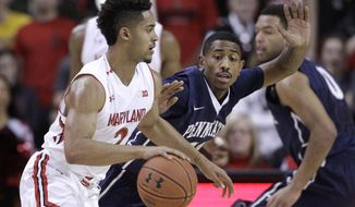 Maryland guard Melo Trimble, left, drives past Penn State guard Geno Thorpe in the first half of an NCAA college basketball game, Wednesday, Feb. 4, 2015, in College Park, Md. (AP Photo/Patrick Semansky)