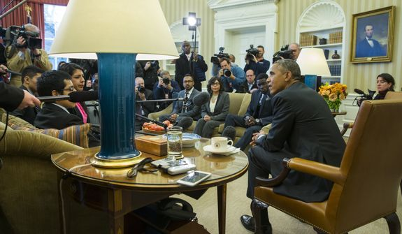 """President Barack Obama meets with a group of """"Dreamers"""" in the Oval Office of the White House in Washington, Wednesday, Feb. 4, 2015. The president is accusing opponents of his immigration action of failing to think about the """"human consequences.""""  The president spoke during an Oval Office meeting Wednesday with six of young immigrants who would be subject to eventual deportation under a bill passed by the House. The legislation would overturn Obama's executive actions limiting deportations for millions here illegally and giving them the ability to work. (AP Photo/Evan Vucci)"""