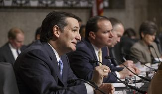 Senate Armed Services Committee member Sen. Ted Cruz, R-Texas, left, joined by Sen. Mike Lee, R-Utah, center, poses questions to Ashton Carter, President Barack Obama's choice to be defense secretary, as he goes before the committee for confirmation to replace Chuck Hagel as Pentagon chief, Wednesday, Feb. 4, 2015, on Capitol Hill in Washington. (AP Photo/J. Scott Applewhite) ** FILE **