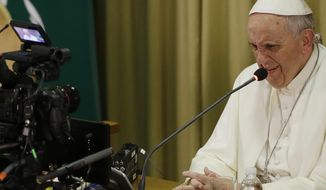 Pope Francis gives his speech in the Synod hall on the occasion of the closing ceremony of the IV Scholas Occurrentes World Educational Congress, at the Vatican, Thursday, Feb. 5, 2015. (AP Photo/Gregorio Borgia)
