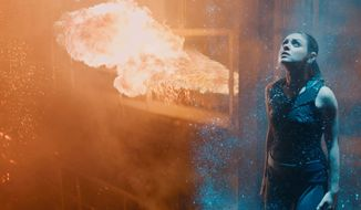 """Mila Kunis portrays Jupiter Jones, the heroine in """"Jupiter Ascending."""" The science fiction space adventure, written and directed by Lana and Andy Wachowski, offers a wealth of spectacular imagery but is weak on plot, character and substance. (Associated Press)"""