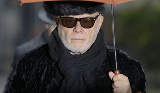 British pop star Gary Glitter, real name Paul Gadd, arrives at Southwark Crown Court in London, Thursday, Feb. 5, 2015. The jury went out Wednesday to consider their verdict. Gadd is facing historic sex abuse charges dating back to the 1970s. (AP Photo/Kirsty Wigglesworth)
