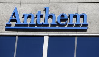 The Anthem logo hangs at the health insurer's corporate headquarters in Indianapolis, Thursday, Feb. 5, 2015. Hackers broke into the company's database storing information for about 80 million people in an attack bound to stoke fears many Americans have about the privacy of their most sensitive information. (AP Photo/Michael Conroy) ** FILE **