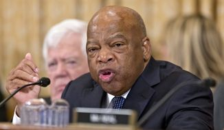 Rep. John Lewis, D-Ga., speaks on Capitol Hill in Washington in this Oct. 29, 2013, file photo. Two prominent House Democrats say they'll skip Prime Minister Benjamin Netanyahu's speech to Congress next month, saying they disapprove of House Speaker John Boehner's decision to invite the Israeli leader without consulting the White House. (AP Photo/J. Scott Applewhite, File)