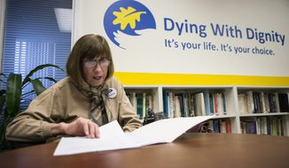 Linda Jarrett reads through notes at Dying with Dignity offices in Toronto, Friday, Feb. 6, 2015. Canada's highest court Friday, unanimously struck down a ban on doctor-assisted suicide for mentally competent patients with terminal illnesses. (AP Photo/The Canadian Press, Chris Young)
