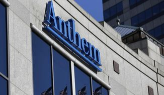The Anthem logo hangs at the health insurer's corporate headquarters in Indianapolis in this Feb. 5, 2015, file photo. (AP Photo/Michael Conroy, File)