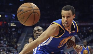 Atlanta Hawks forward Paul Millsap knocks the ball away from Golden State Warriors Warriors guard Stephen Curry during an NBA basketball game, Friday Feb. 6, 2015 in Atlanta. (AP Photo/Atlanta Journal-Constitution, Curtis Compton)  MARIETTA DAILY OUT; GWINNETT DAILY POST OUT; LOCAL TELEVISION OUT; WXIA-TV OUT; WGCL-TV OUT