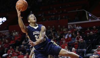 George Washington's Joe McDonald (22) takes an off-balance shot during the first half of an NCAA college basketball game against Rutgers Sunday, Nov.16, 2014, in Piscataway, N.J. (AP Photo/Mel Evans)