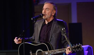 """Neil Diamond performed for the first time in his hometown in Brooklyn last year, at his alma mater Erasmus Hall High School, to introduce his latest album, """"Melody Road."""" He says he isn't wasting precious time with his singing and songwriting talents. (Associated Press)"""