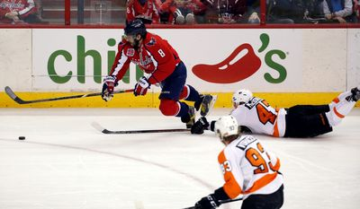 Flyers defenseman Andrew MacDonald (47) trips Capitals left wing Alex Ovechkin in the third period of Sunday's game. MacDonald received a penalty on the play.