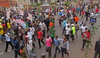 People take part in a march to show their support for the Cameroon army fighting against Boko Haram militants in the city of Yaounde, Cameroon, Saturday, Feb. 7, 2015. Boko Haram staged an overnight assault on a border town in Niger, residents said Sunday, the second time the West African nation has come under attack by the Nigeria-based extremists since Friday. (AP Photo/Joel Kouam)