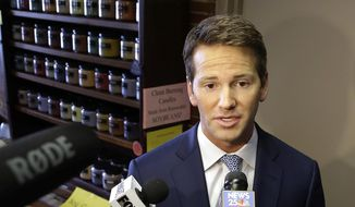 Republican U.S. Rep. Aaron Schock speaks to reporters in Peoria, Ill., before meetings with constituents in this Feb. 6, 2015, file photo. (AP Photo/Seth Perlman, File)