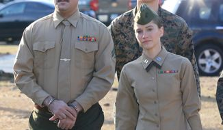 Cpl. Wassef Hassoun, left, is escorted to the courtroom on Camp Lejeune in Jacksonville, N.C., Monday, Feb. 9, 2015, for the beginning of his court martial trial. The U.S. Marine who vanished from his post in Iraq a decade ago and later wound up in Lebanon chose Monday to have his case decided by a military judge instead of a jury. Hassoun's military defense attorney Capt. Brittaney Bennett walks with him. (AP Photo/The Daily News, John Althouse)