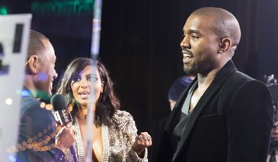 Kim Kardashian and Kanye West are interviewed at the 57th Annual Grammy Awards Official After Party on Sunday, Feb. 9, 2015 in Los Angeles, CA. (Photo by Colin Young-Wolff/Invision/AP)