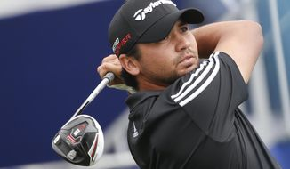 Jason Day, from Australia, watches his tee shot on the seventh hole of the south course at Torrey Pines during the final round of the Farmers Insurance Open golf tournament Sunday, Feb. 8, 2015, in San Diego. (AP Photo/Lenny Ignelzi)