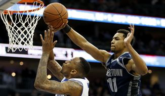 Seton Hall forward Brandon Mobley, left, goes up for a shot against Georgetown forward Isaac Copeland during the second half of an NCAA college basketball game, Tuesday, Feb. 10, 2015, in Newark, N.J. Georgetown won 86-67.  (AP Photo/Julio Cortez)