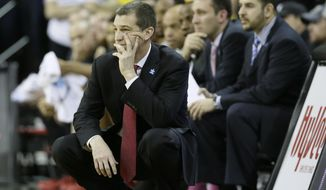 Maryland head coach Mark Turgeon watches from the bench during the first half of an NCAA college basketball game against Iowa, Sunday, Feb. 8, 2015, in Iowa City, Iowa. (AP Photo/Charlie Neibergall)